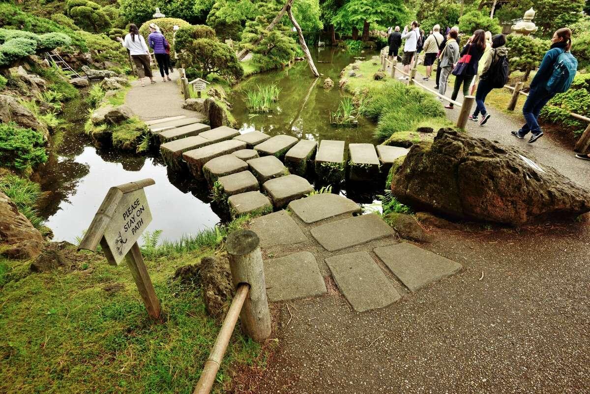 Visitors walk through the Japanese tea garden.