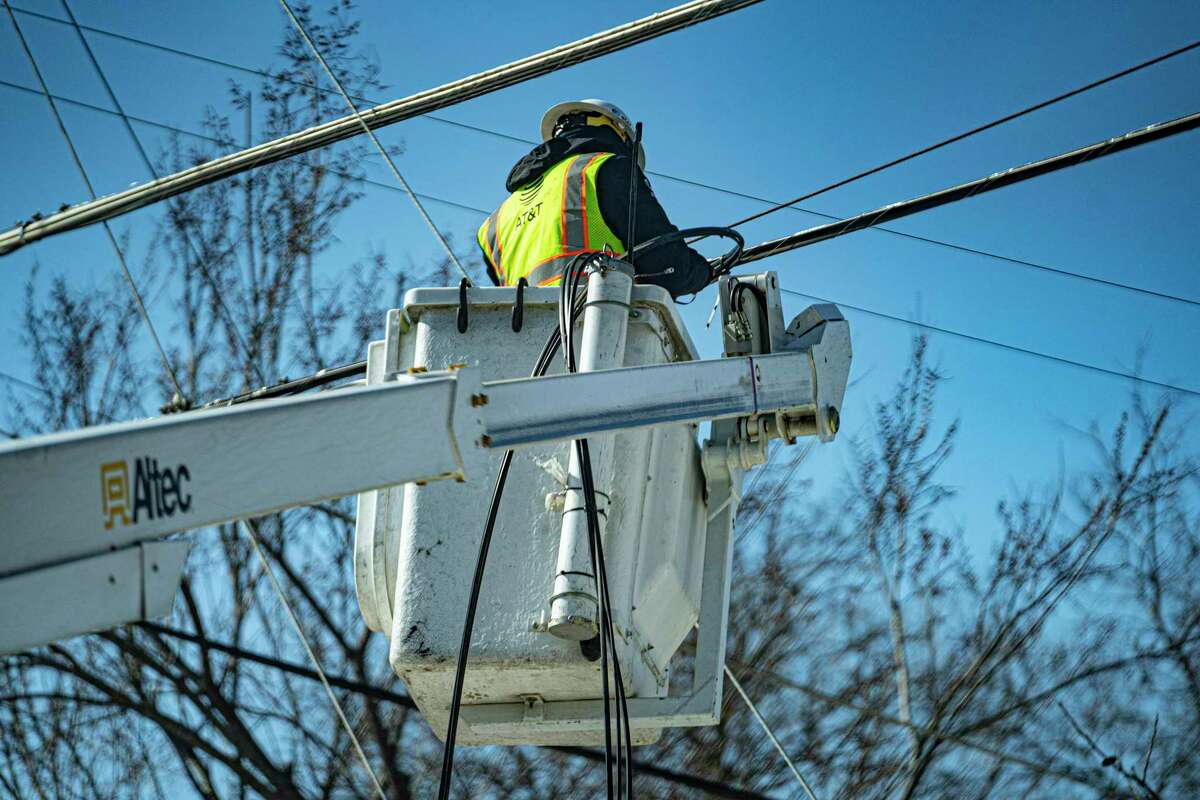 Workers restore services in Dallas on Thursday, Feb. 19, 2021, where amid widespread power losses, millions of Texans were advised to boil their water for safety. DeAnn T. Walker, who has been the chairwoman of the Public Utility Commission of Texas since 2017, had been caught in a tide of fury that has swelled across Texas after the outages left millions without electricity during some of the coldest temperatures ever recorded in the state. (Nitashia Johnson/The New York Times)