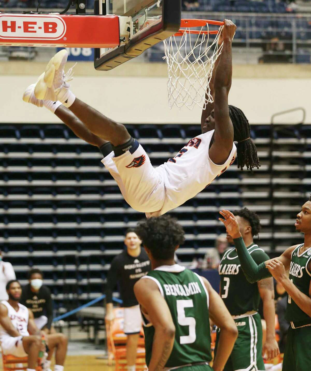 UTSA's Keaton Wallace follows through on a dunk against the University of Alabama Birmingham during men's basketball at the Convocation Center on Friday, Feb. 26, 2021. UTSA goes down, 57-64, to UAB and will play again on Saturday.