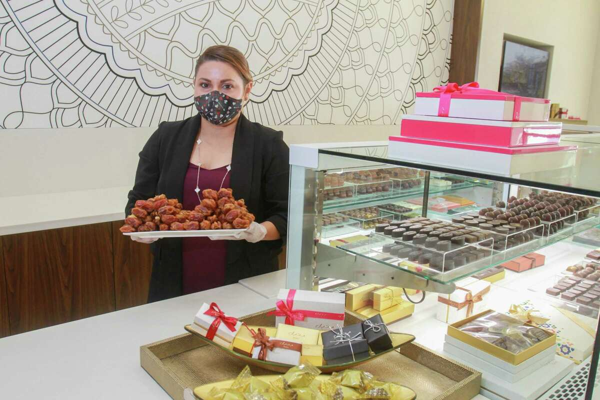 Manager Veronica Robles with Kholas caramelized roasted dates at Bateel, a luxury date (and confectionary) shop that recently opened in Houston.