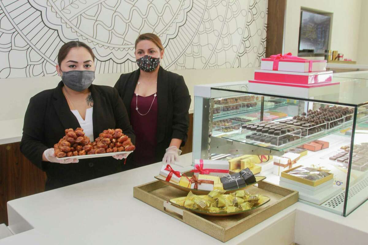 Karla Navarro, left, holding Kholas caramelized roasted dates, and manager Veronica Robles at Bateel, a luxury date (and confectionary) shop that recently opened in Houston.
