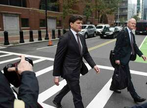 Greenwich attorney Gordon Caplan exits after his sentencing at the John Joseph Moakley United States Courthouse in Boston on Thursday, Oct. 3, 2019. Caplan was sentenced to one month in prison for paying $75,000 to improve his daughter's scores on a college admissions test. He was busted as part of the Varsity Blues federal sting operation that ensnared 50 people in crimes involving bribery and manipulating college entrance exam scores.
