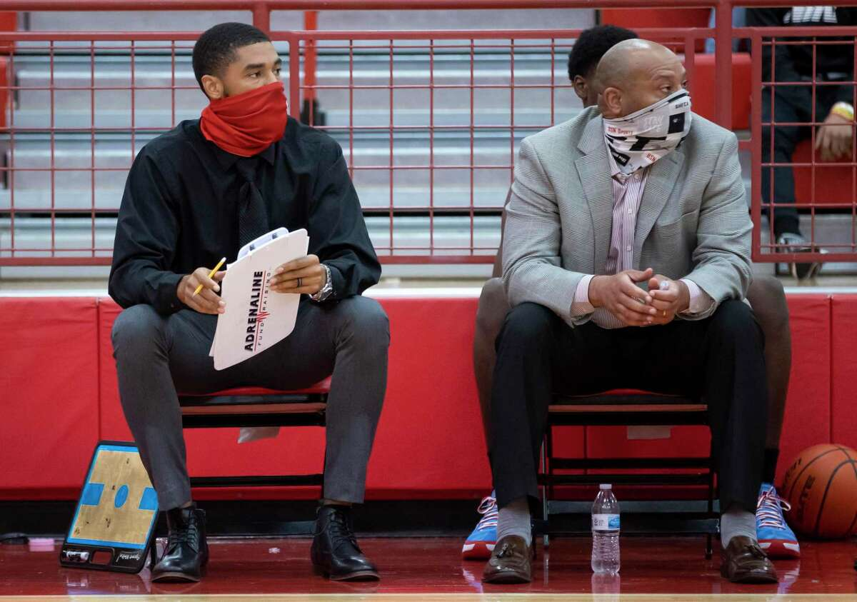 Crosby coach LeRon Barnes, left and head coach Edwin Egans watch as their team plays defense during the third quarter of a District 21-5A basketball game against Beaumont United at Crosby High School, Friday, Jan. 22, 2021, in Crosby.