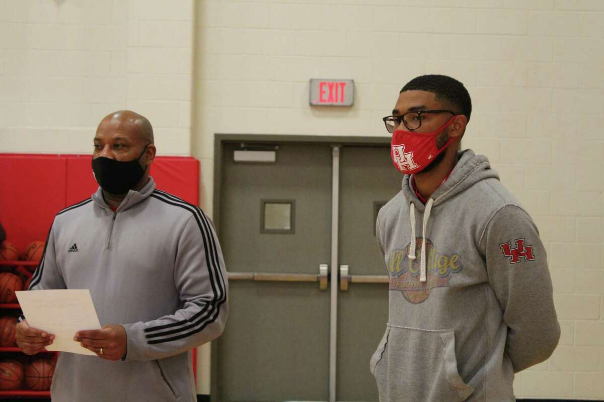 Crosby head coach Edwin Egans (left) and assistant LeRon Barnes (right) watching during warmup drills at practice.