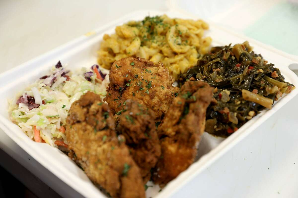 Vegan chicken, cole slaw, macaroni and cheese, and collard greens fill a plate at Vegan Mob. The Oakland restaurant is expanding to San Francisco and San Jose.