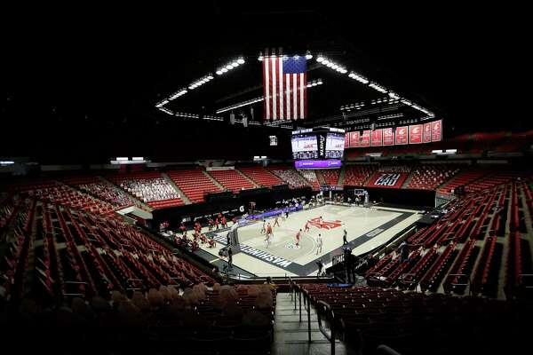 FILE - Washington State and Utah play the first half of an NCAA college basketball game at Beasley Coliseum without fans present due to the COVID-19 pandemic, in Pullman, Wash., in this Thursday, Jan. 21, 2021, file photo. Since the season began Nov 25, more than 715 men's basketball games have been postponed, rearranged or simply called off, according to an AP analysis through Friday's, Feb. 5, 2021, games, and the news was similar for women's teams. (AP Photo/Young Kwak, File)