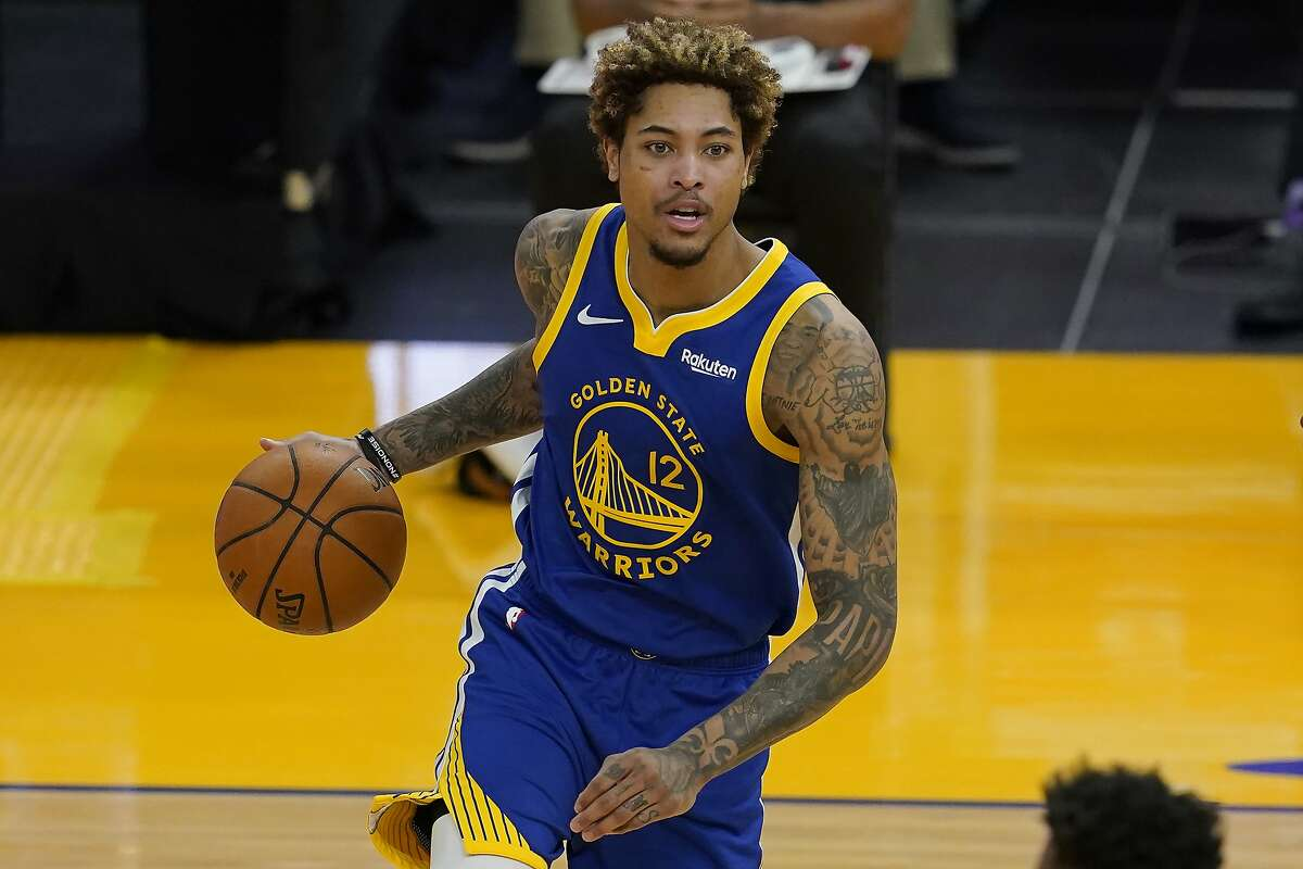 Golden State Warriors guard Kelly Oubre Jr. (12) against the Charlotte Hornets during an NBA basketball game in San Francisco, Friday, Feb. 26, 2021. (AP Photo/Jeff Chiu)