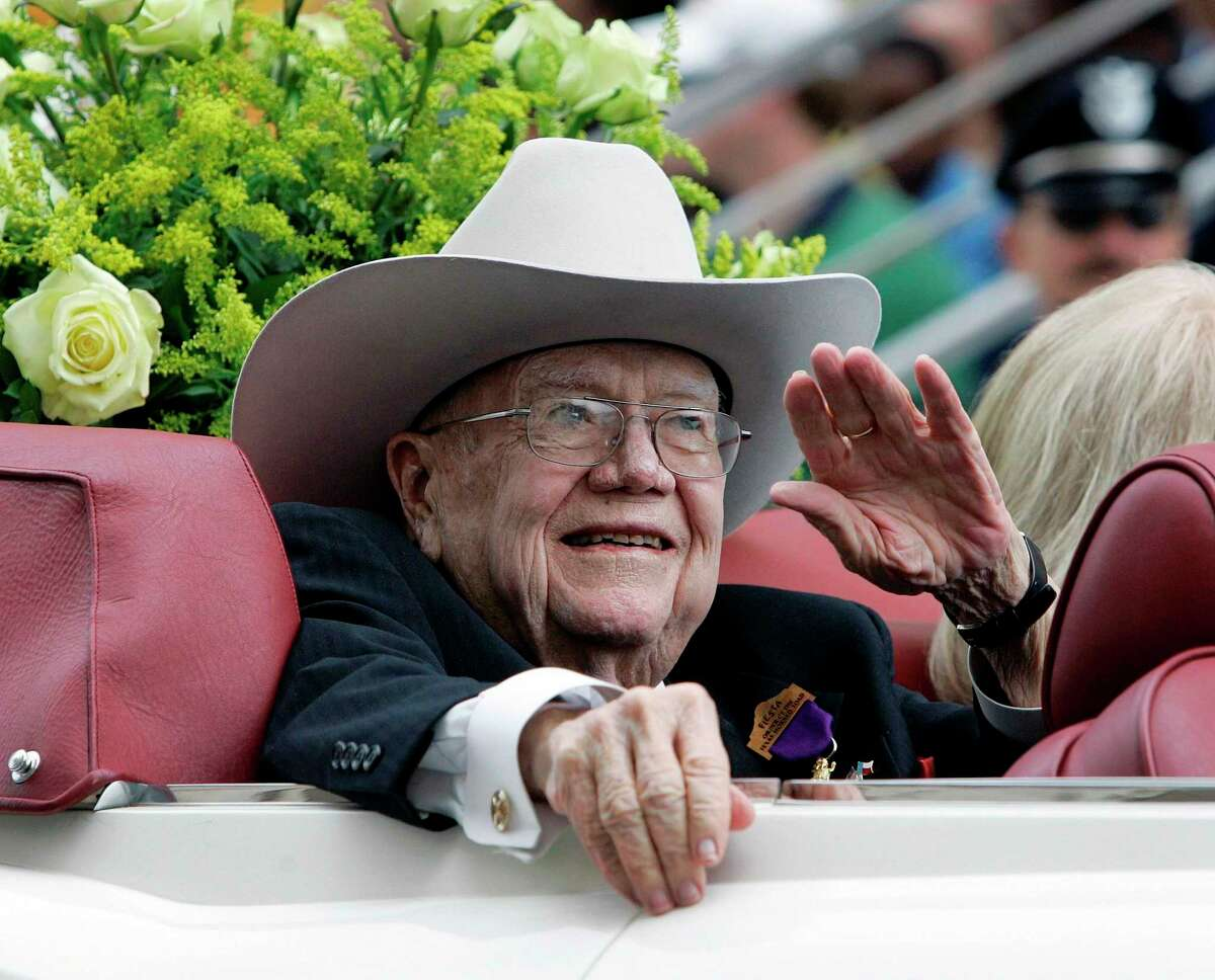 In this April 25, 2008 file photo, former Texas Governor Dolph Briscoe, Honorary Grand Marshal, waves as he takes part in Fiesta's Battle of Flowers Parade in San Antonio. Briscoe died at his Uvalde home at the age of 87 in 2010.