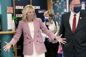 First lady Jill Biden and Education Secretary Miguel Cardona tour Benjamin Franklin Elementary School, Wednesday.