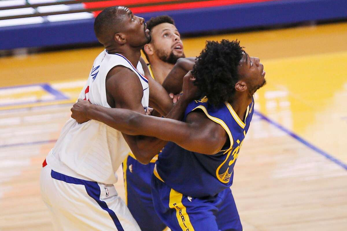 Golden State Warriors center James Wiseman on a defensive box out against Los Angeles Clippers forward Serge Ibaka in the first quarter of an NBA game against the Los Angeles Clippers at Chase Center, Friday, Jan. 8, 2021, in San Francisco, Calif.