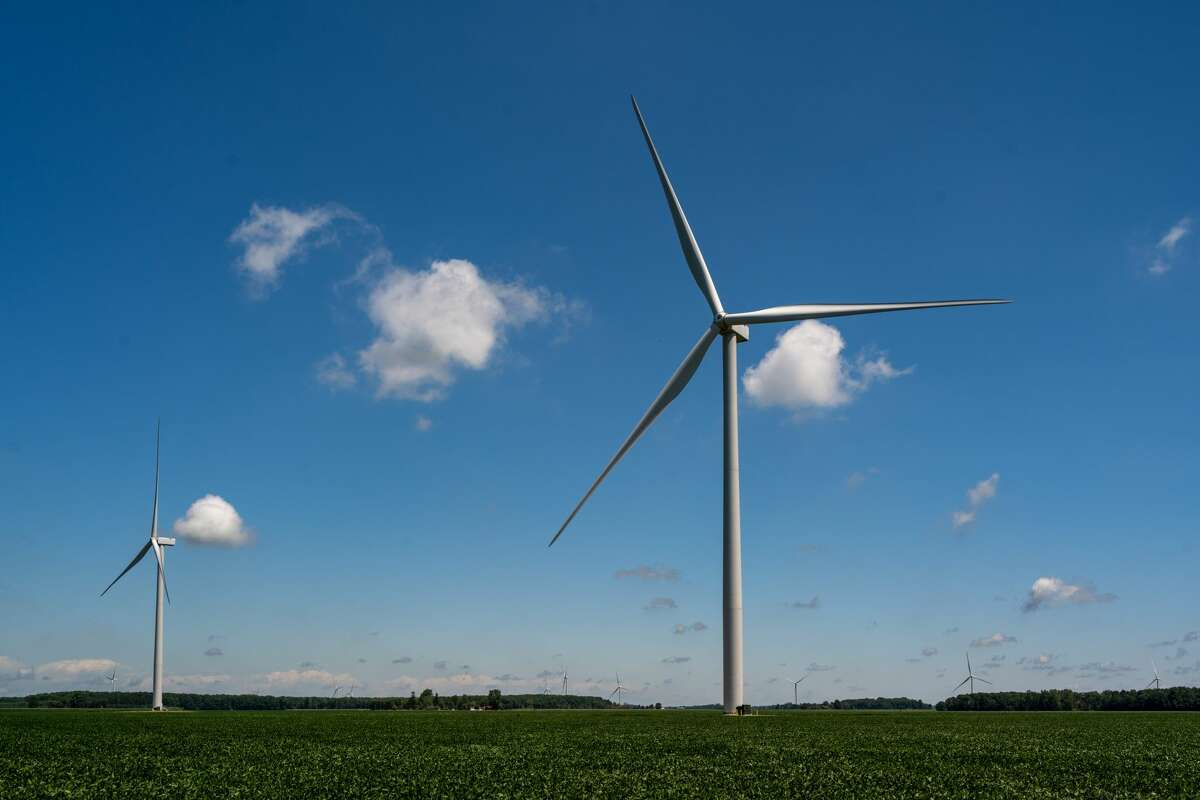 FILE - Turbines stand in a field at DTE's Polaris Wind Park in Gratiot County.