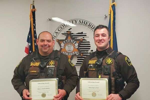Tuscola County Sheriff Glen Skrent awarded Lifesaving Citations to Deputies Jon Ramirez and Ryan LaFlure for saving the life of an 18-year old man. (Courtesy Photo)