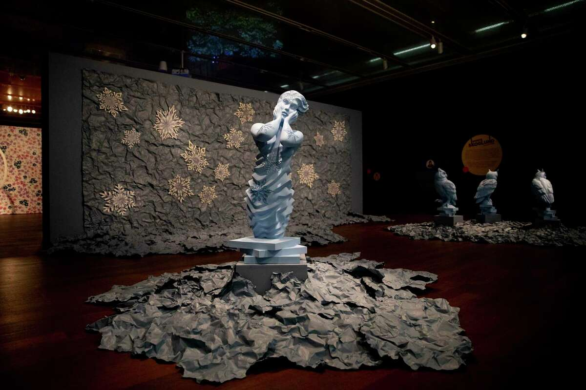 """Sandy Skoglund """"Winter installation"""" includes sculptures, snowflakes and a photograph depicting a family within it. The work is on display at the McNay Art Museum."""