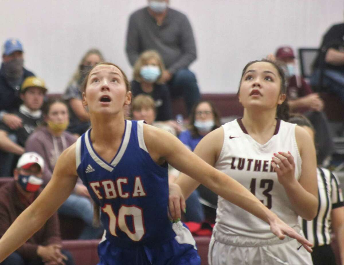 Pasadena-FBCA's Brenna Fuller tries to keep San Antonio Lutheran's Dani Fischer out of the paint during their state playoff game in San Antonio Tuesday night.