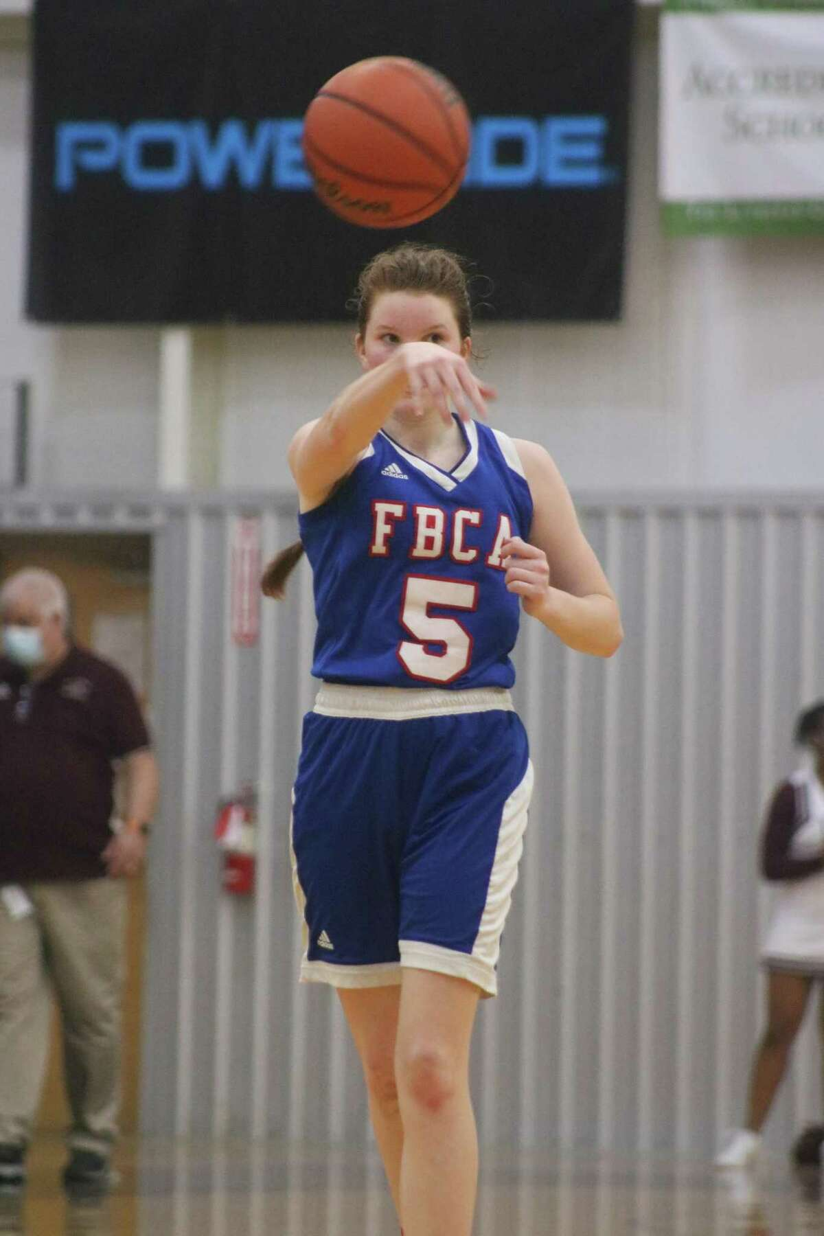 """Keeleigh Wilbanks passes to a teammate during second-half play Tuesday night.in San Antonio. The San Antonio Lutheran head coach called Wilbanks """"A tough kid."""""""