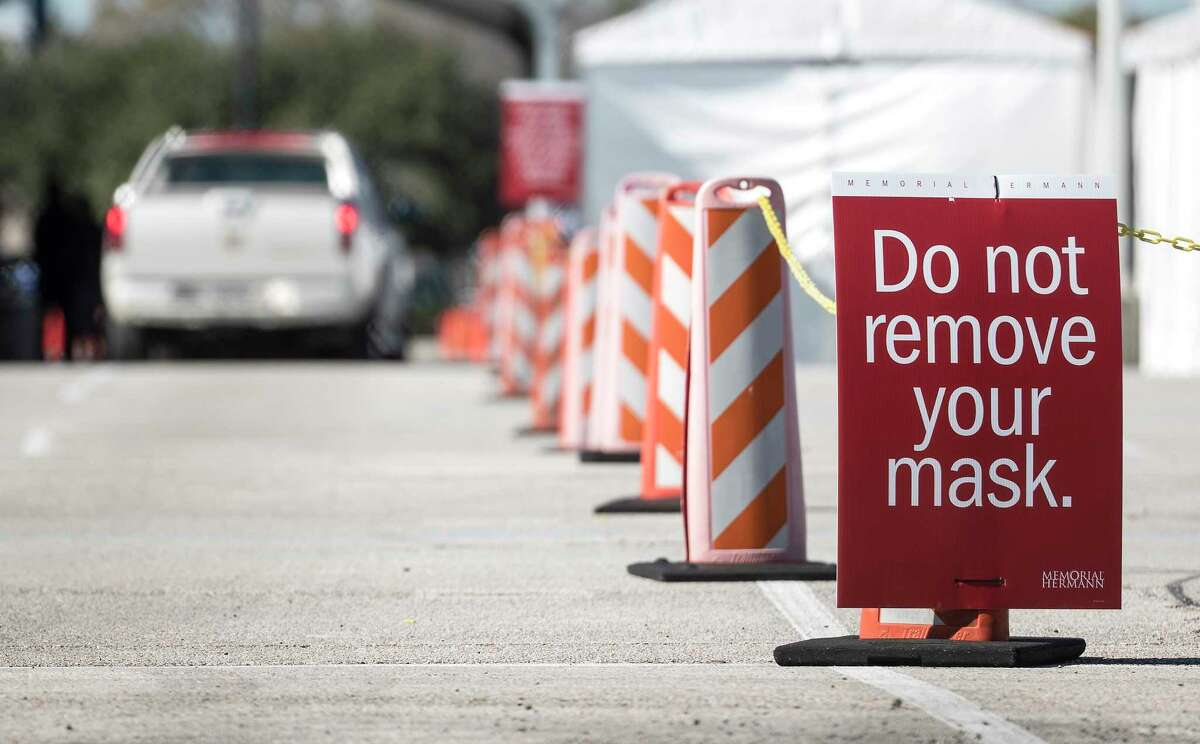 Covid-19 vaccinations are given during a drive-thru vaccination site implemented by Memorial Hermann in the Yellow Lot at NRG Park on Thursday, Jan. 14, 2021 in Houston.