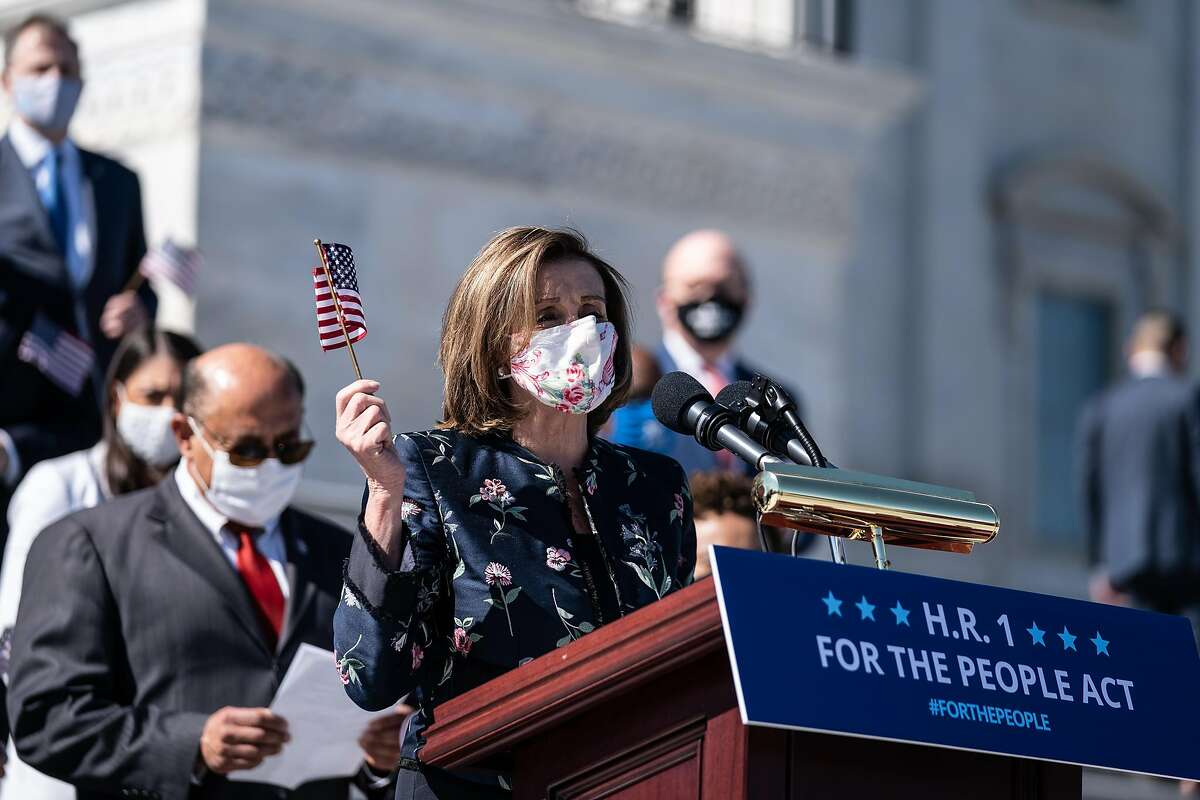 House Speaker Nancy Pelosi promoting Democrats' omnibus political reform bill, HR1, in front of the Capitol on Wednesday.