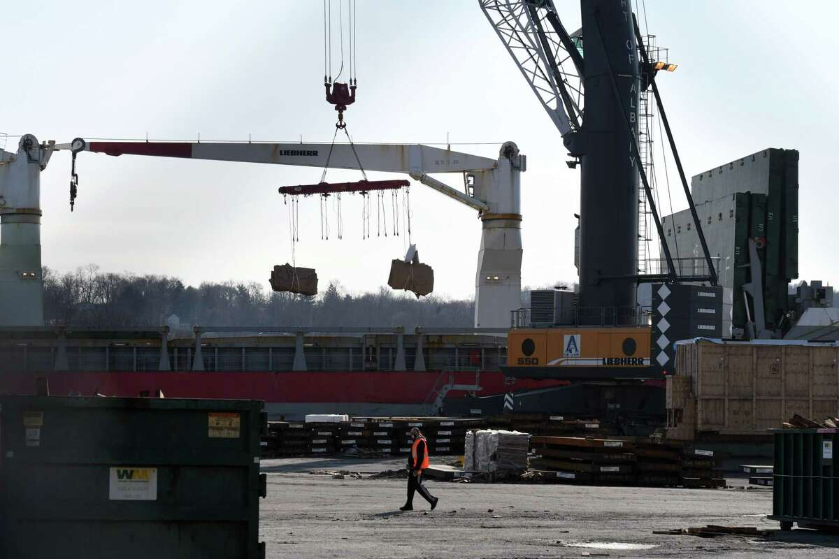 Cargo is unloaded from a vessel at the Port of Albany on Wednesday March 3, 2021, in Albany N.Y. The port is planning a major offshore wind assembly operation to supply offshore wind farms being built off Long Island. (Will Waldron/Times Union)