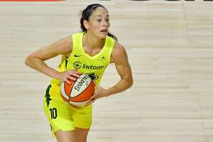 PALMETTO, FLORIDA - OCTOBER 06: Sue Bird #10 of the Seattle Storm passes the ball during the second half of Game 3 of the WNBA Finals against the Las Vegas Aces at Feld Entertainment Center on October 06, 2020 in Palmetto, Florida. NOTE TO USER: User expressly acknowledges and agrees that, by downloading and or using this photograph, User is consenting to the terms and conditions of the Getty Images License Agreement. (Photo by Julio Aguilar/Getty Images)
