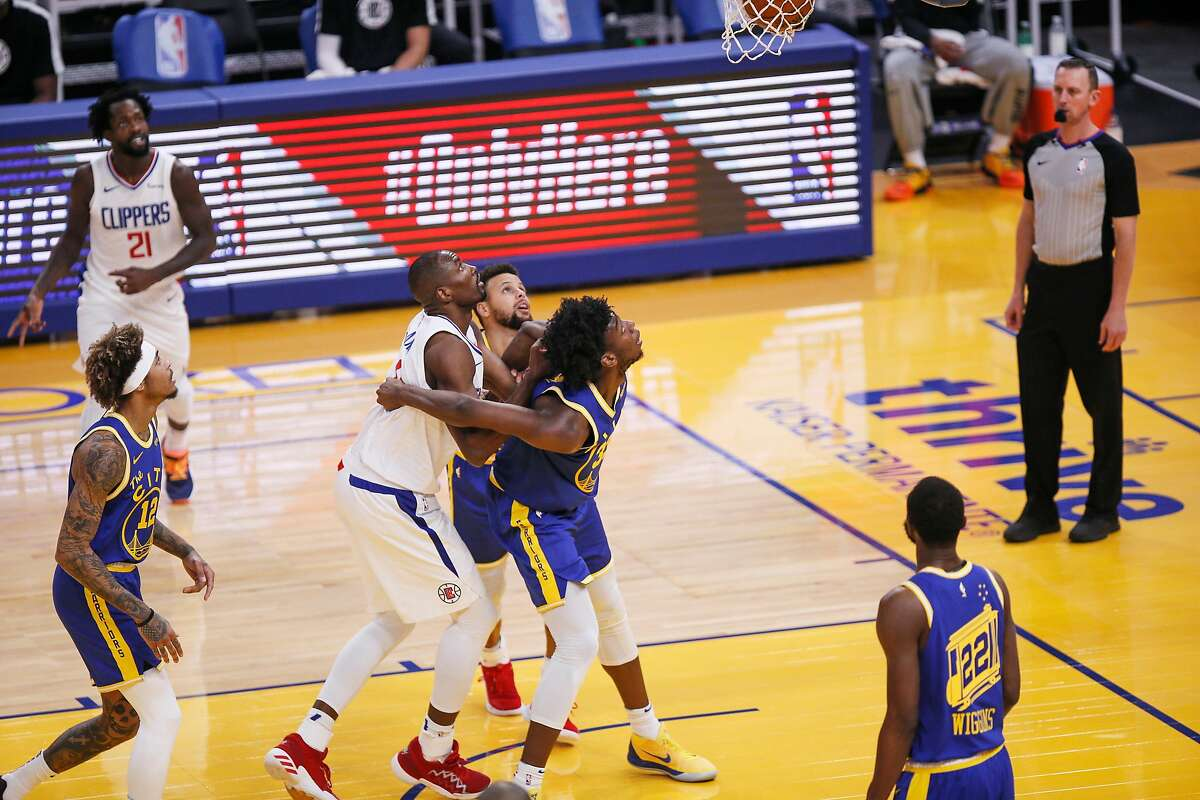 Golden State Warriors center James Wiseman on a defensive box out against Los Angeles Clippers forward Serge Ibaka in the first quarter of a Jan. 8 game at Chase Center.