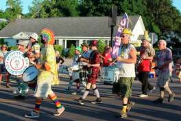 In this file photo, members of the Scottville Clown Band march in a number of creative costumes during the Bear Lake Days parade. (File photo)