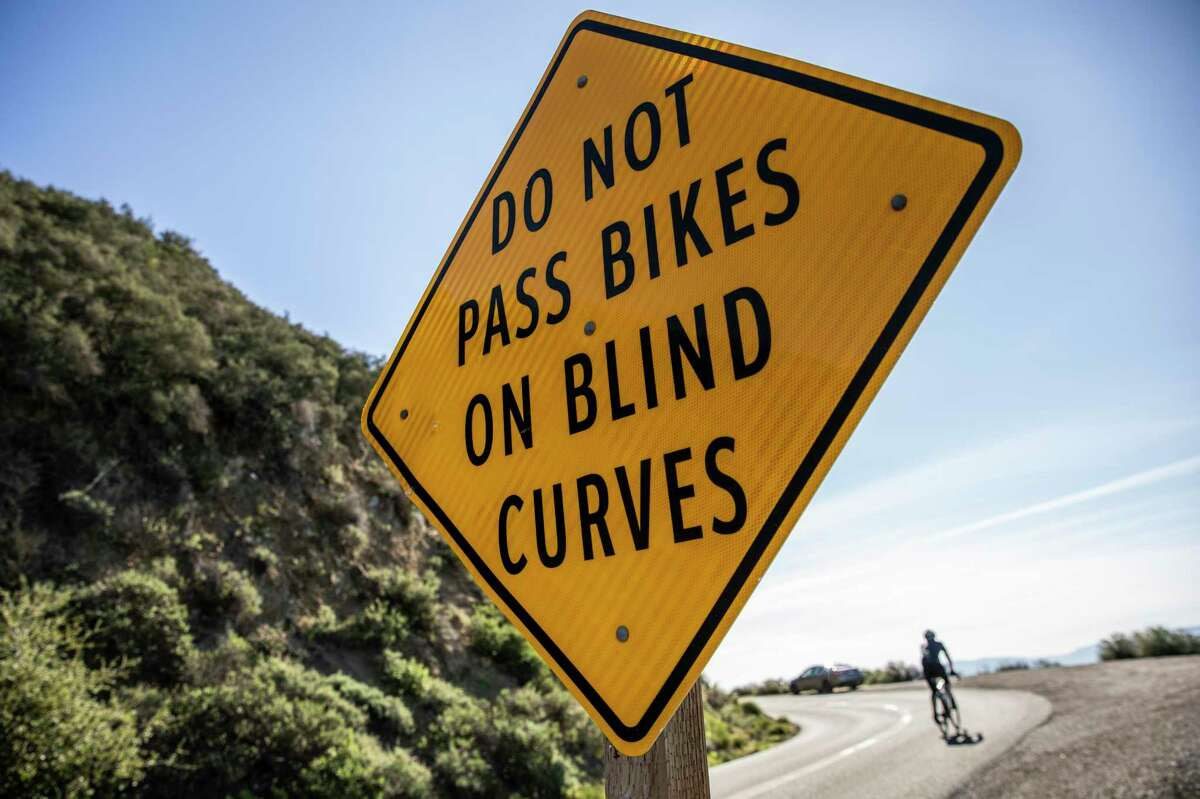 A sign to discourage motorists from passing bicycles on blind curve on South Gate Road on Mount Diablo.