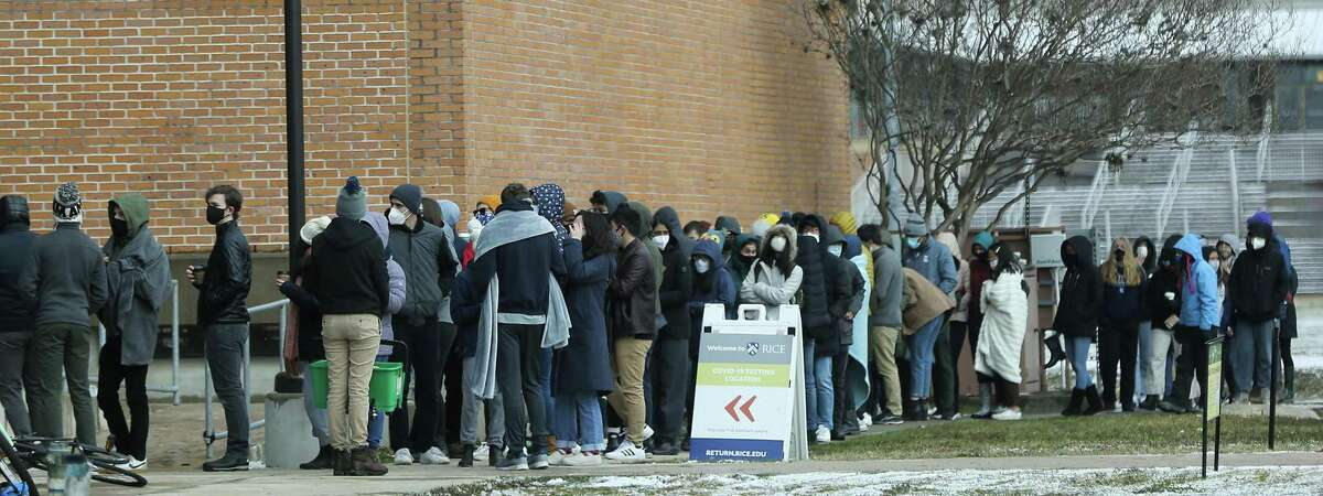 People line up to receive the COVID-19 vaccine at Rice University in Houston on Monday, Feb. 15, 2021. Officials said 1,000 doses of Moderna vaccine had to be used by 5 p.m., but the winter freeze had ruined the initial rollout plans. As a result, anyone on campus could get a dose on a first-come, first-served basis.