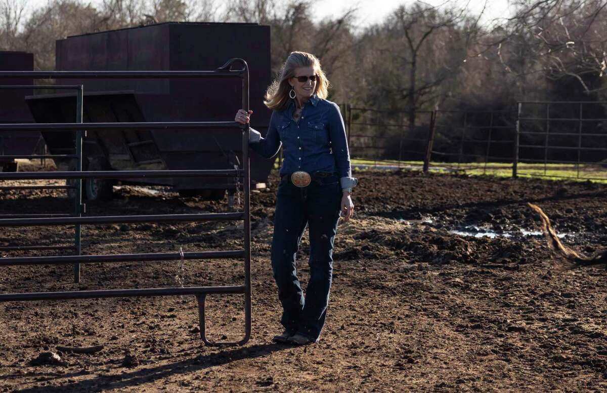 Director Darla Weaver releases cattle from the feeding area at Three Cross Ministry, Tuesday, March 2, 2021, in Montgomery. Lone Star Cowboy Church's Three Cross Meat Ministry, formerly Lone Star Beef, has a goal to provide 72,000 meals in 2021.