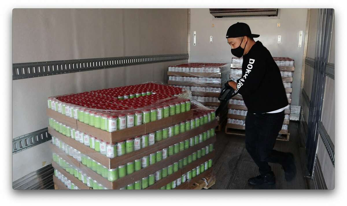 Youngwon Lee prepares shipments of beers for delivery.