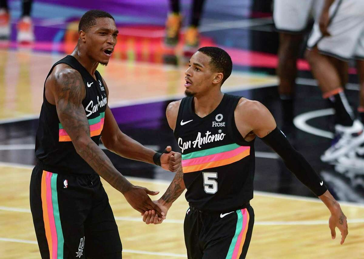 DeJounte Murray of the San Antonio Spurs (5) is greeted by teammate Lonnie Walker IV after scoring on a last-second shot to tie the game at 108 against the Brooklyn Nets, sending it into overtime at the AT&T Center on Monday, March 1, 2021. The Nets won, 124-113.