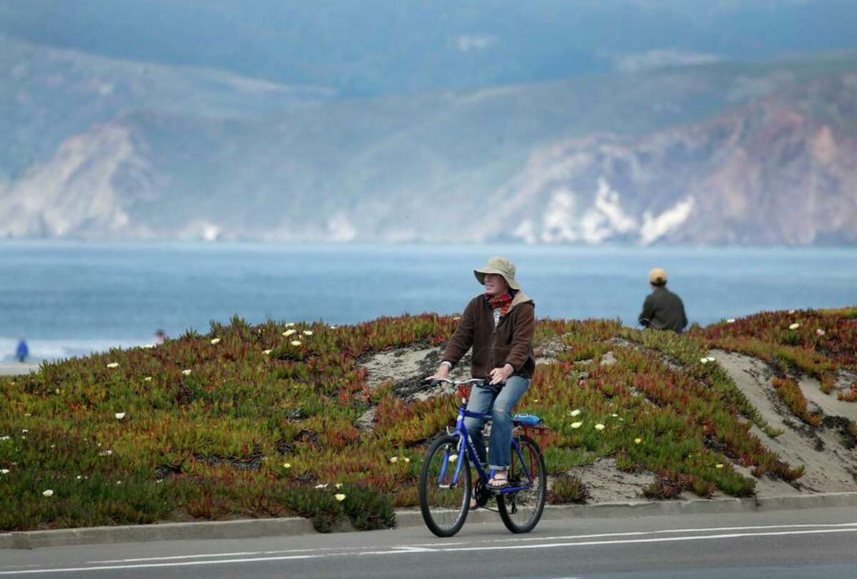 A bicyclist cruises down the Great Highway during the coronavirus pandemic in San Francisco.