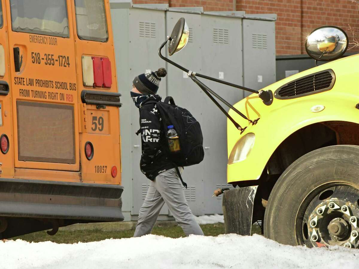Students are seen leaving Schenectady High School as the school dismisses for the day on Wednesday, March 3, 2021 in Schenectady, N.Y. A report from the Empire Center for Public Policy in March 2021 said public school enrollment is continuing to decline. (Lori Van Buren/Times Union)