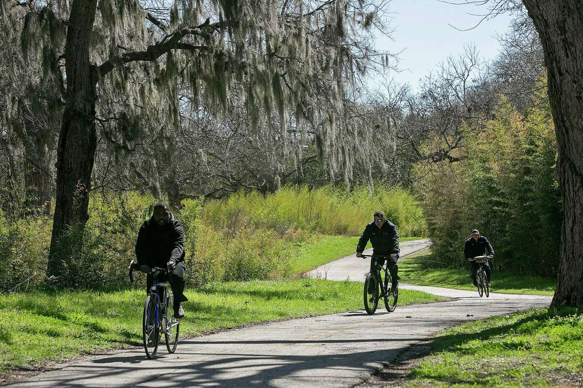 Langston Prince, from left, Jared Schoenvogel and Rudy Terrazas ride on the Salado Creek Greenway, part of the Howard W. Peak Greenway Trails System, during their lunch break on Tuesday, March 2, 2021. The chairman of the local linear creeks committee says the city is becoming recognized as a destination for cyclists.