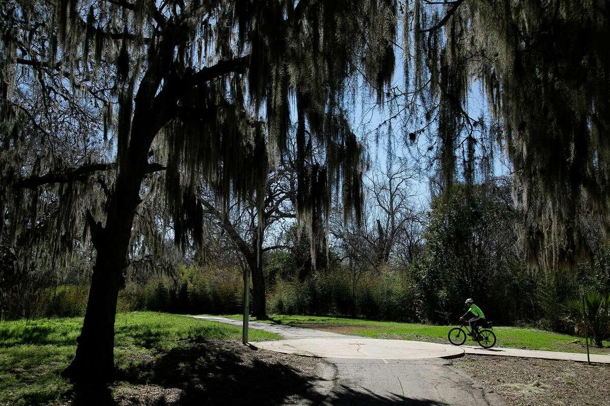 A trail steward rides on the Salado Creek Greenway on Tuesday, March 2, 2021.