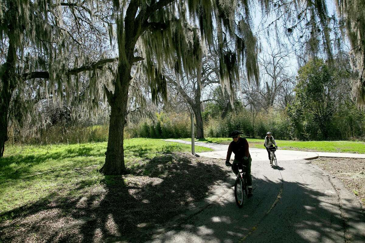 Henry Roberson and Alicia Nelson ride on the Salado Creek Greenway by the J Street Park Trailhead. The two are part of a group of five who started riding together at the start of the pandemic. They have now covered all open sections of the greenway system.