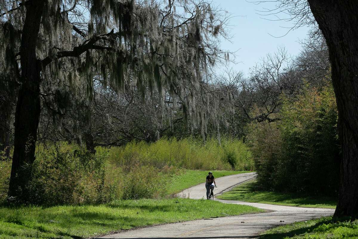 A cyclist cruises the Salado Creek Greenway in March. This should be at the top of the city's bond issue.