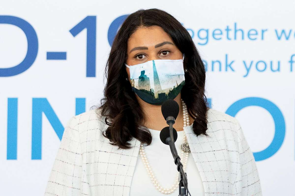 In this file photo, San Francisco Mayor London Breed speaks alongside healthcare leaders to announce the opening of a mass COVID-19 vaccination site at Moscone South in San Francisco, Calif. Thursday, February 4, 2021. Breed said Tuesday that the city could enter the state's less restrictive orange reopening tier as soon as March 24.
