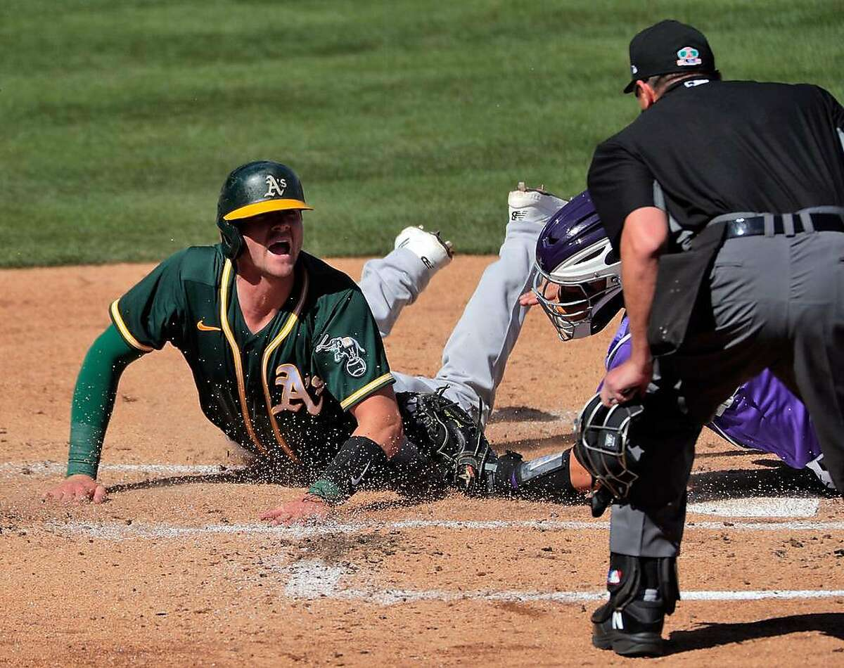 A's catcher Austin Allen, left, spent the offseason working on his offense and defense after being sent to the team's alternate site last season.