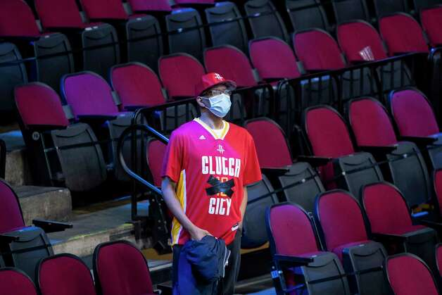 A Rockets fan with the 13 crossed out on his Rockets shirt watches from the arena at the end of the fourth quarter of a game between the Houston Rockets and Brooklyn Nets on Wednesday, March 3, 2021, at Toyota Center in Houston. The game is the first for James Harden against Houston since leaving the team earlier this season. Photo: Mark Mulligan, Staff Photographer / © 2021 Mark Mulligan / Houston Chronicle