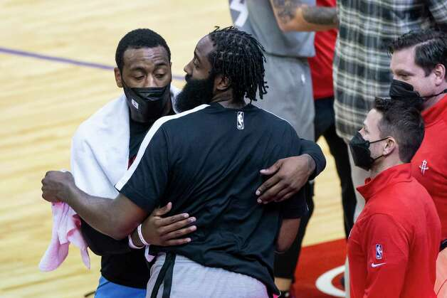 Houston Rockets guard John Wall (1) hugs Brooklyn Nets guard James Harden (13) after the fourth quarter of a game between the Houston Rockets and Brooklyn Nets on Wednesday, March 3, 2021, at Toyota Center in Houston. The game is the first for Harden against Houston since leaving the team earlier this season. Photo: Mark Mulligan, Staff Photographer / © 2021 Mark Mulligan / Houston Chronicle