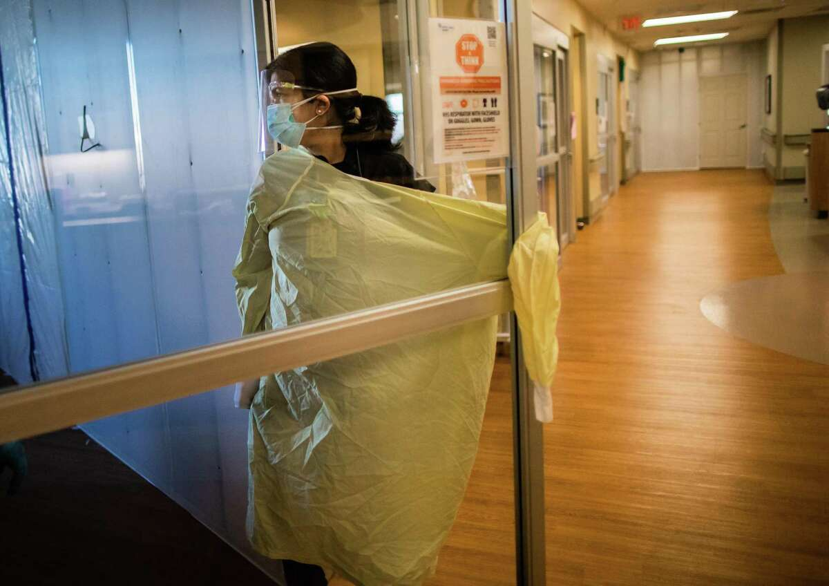 CHI St. Luke's Health-Sugar Land pulmonologist Dr. Manpreet Mangat enters the room of a patient during her morning rounds at an intense care unit, Wednesday, March 3, 2021, in Sugar Land.