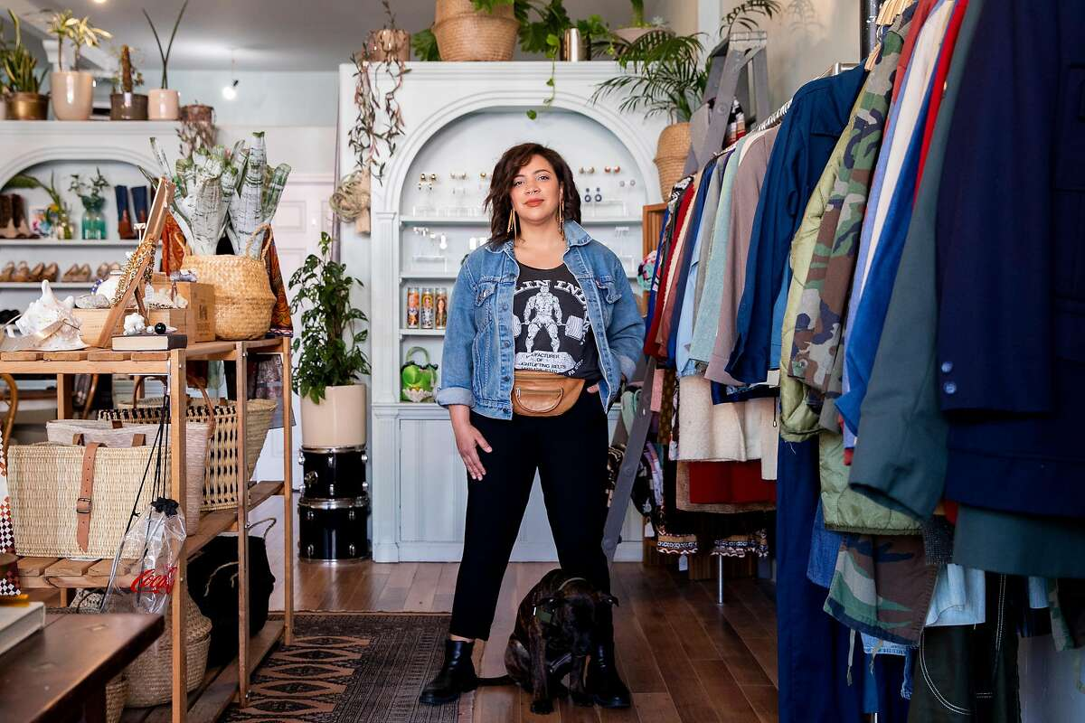Morgan Mapes stands inside the Golden Hour, her shop on Clement Street. San Francisco leaders want to use the city's $125 million surplus to help small businesses, among other things.