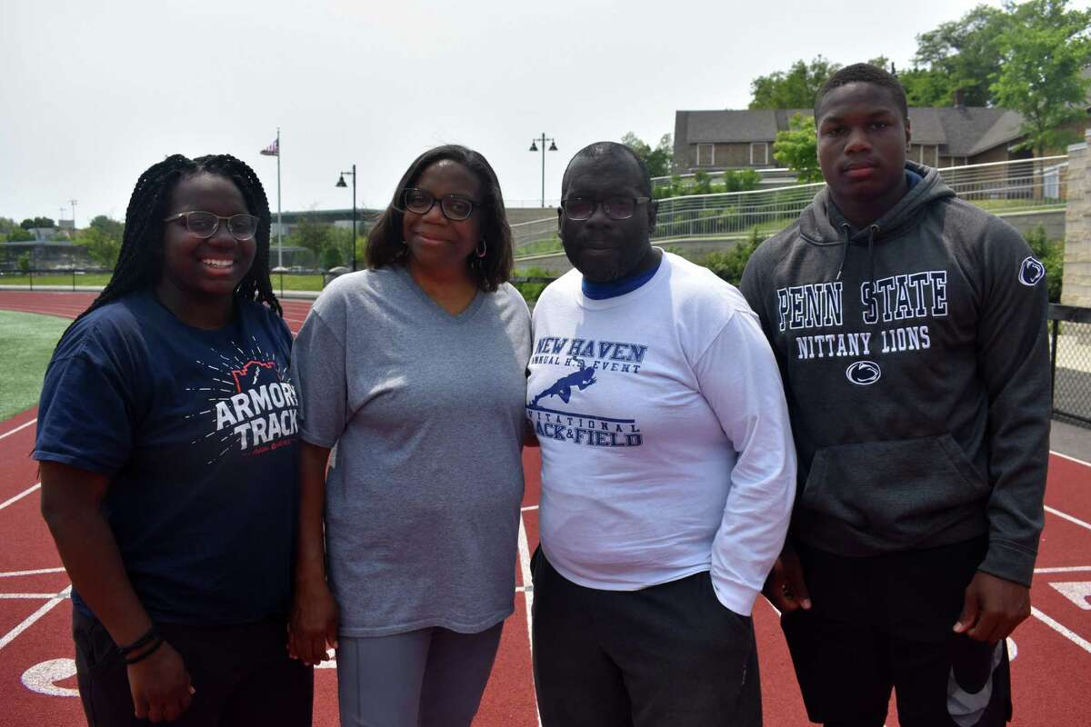 From left, Leah Moore, Hillhouse boys track coach Michele Moore, Hillhouse girls track coach Gary Moore and Gary Moore Jr.