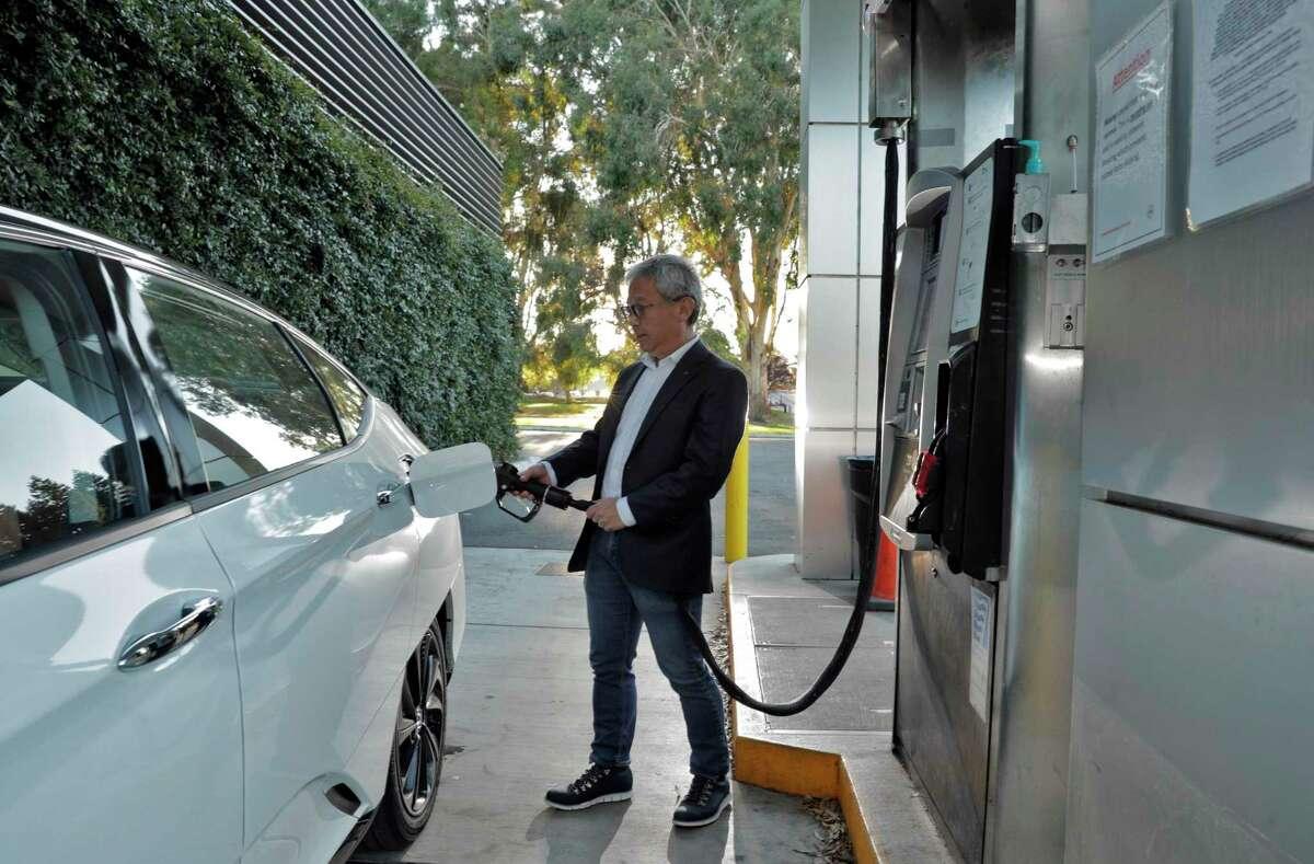 Tadashi Ogitsu refuels his hydrogen fuel cell Honda Clarity near his home in San Ramon, Calif., on Wednesday, November 25, 2020.