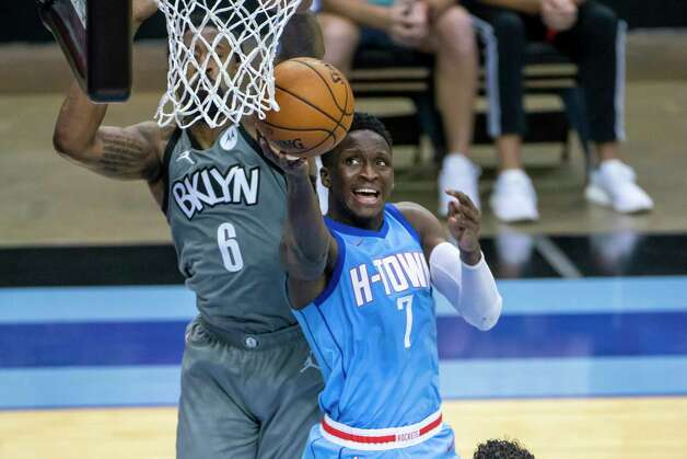 Houston Rockets guard Victor Oladipo (7) shoots around Brooklyn Nets center DeAndre Jordan (6) during the fourth quarter of a game between the Houston Rockets and Brooklyn Nets on Wednesday, March 3, 2021, at Toyota Center in Houston. Photo: Mark Mulligan, Staff Photographer / © 2021 Mark Mulligan / Houston Chronicle