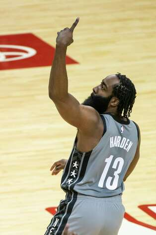 Brooklyn Nets guard James Harden (13) celebrates a made three point shot during the first quarter of a game between the Houston Rockets and Brooklyn Nets on Wednesday, March 3, 2021, at Toyota Center in Houston. The game is the first for Harden against Houston since leaving the team earlier this season. Photo: Mark Mulligan, Staff Photographer / © 2021 Mark Mulligan / Houston Chronicle