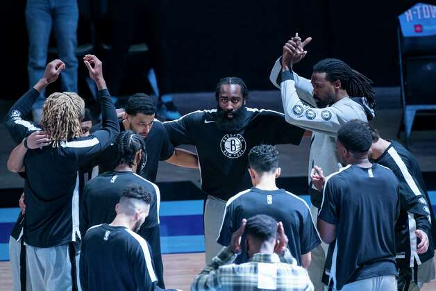 Brooklyn Nets guard James Harden (13) looks up from the Nets huddle before the first quarter of a game between the Houston Rockets and Brooklyn Nets on Wednesday, March 3, 2021, at Toyota Center in Houston. The game is the first for Harden against Houston since leaving the team earlier this season. Photo: Mark Mulligan, Staff Photographer / © 2021 Mark Mulligan / Houston Chronicle