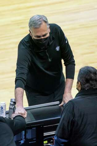 Current Nets assistant coach and former Rockets head coach Mike D'Antoni talks to people on the sideline before the first quarter of a game between the Houston Rockets and Brooklyn Nets on Wednesday, March 3, 2021, at Toyota Center in Houston. The game is the first for Harden against Houston since leaving the team earlier this season. Photo: Mark Mulligan, Staff Photographer / © 2021 Mark Mulligan / Houston Chronicle