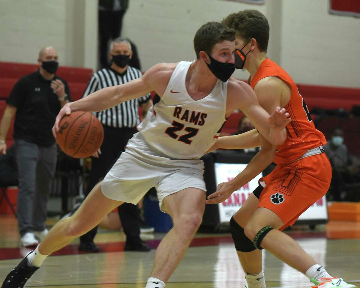 New Canaan's Denis Mulcahy (22) drives to the hoop during a boys basketball game against Ridgefield at New Canaan High School on Wednesday.