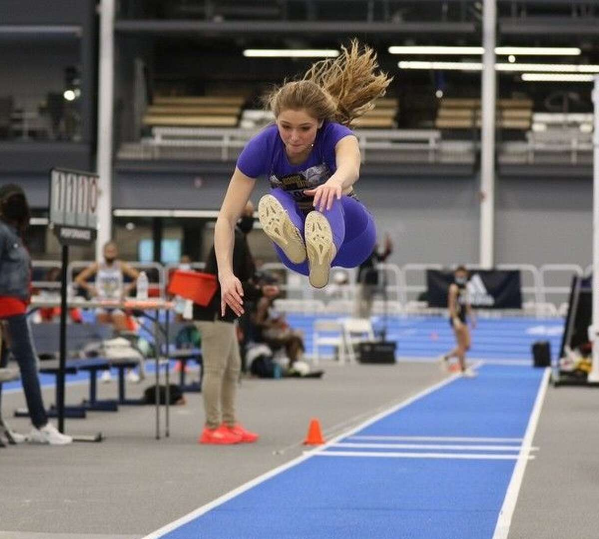 Gianna Locci of Stillwater High School competes in the long jump. (Courtesy of Chris Locci)
